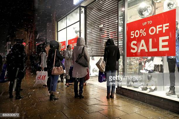Shoppers wait for shops to open along Edinburgh's Princes Street for the Boxing Day sales