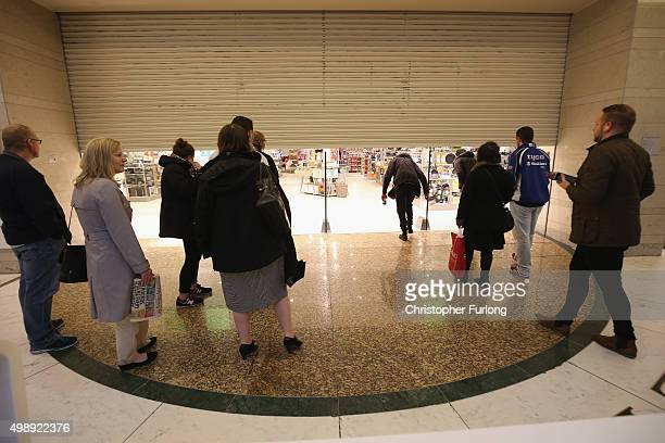 Shoppers wait for the the John Lewis store to open at 8am inside The Trafford Centre with the hope of a 'Black Friday' bargain on November 27 2015 in...