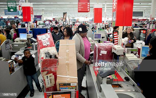 Shoppers wait in a check out line at Kmart during the Black Friday sales on November 23 2012 in Braintree Massachusetts Black Friday the start of the...