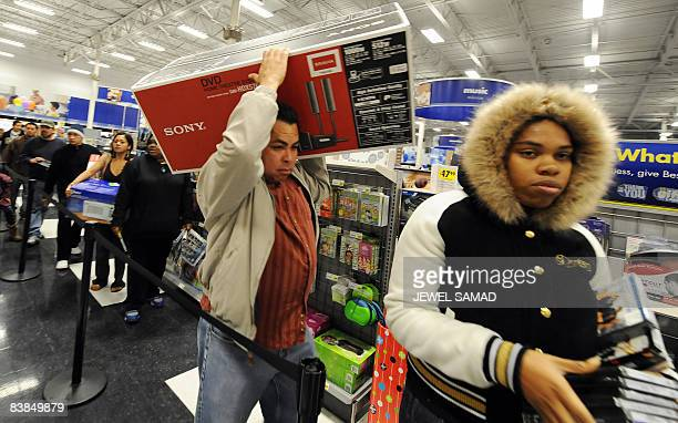 Shoppers wait in a queue to pay at a BestBuy store on November 28 2008 in Los Angeles California a day after Thanksgiving Thousands of shoppers...