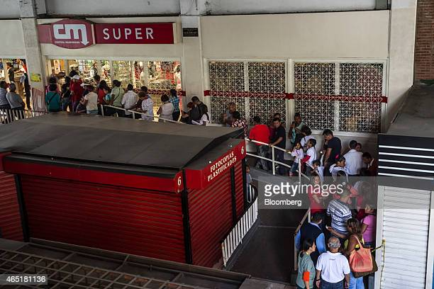 Shoppers wait in line outside a privatesector grocery store in Caracas Venezuela on Wednesday Feb 18 2015 In Venezuela which has the world's largest...