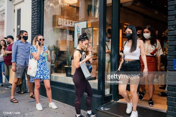 Shoppers wait in line to get enter the Birkenstock store in the SoHo neighborhood of New York, U.S., on Wednesday, Aug. 25, 2021. Consumer spending...