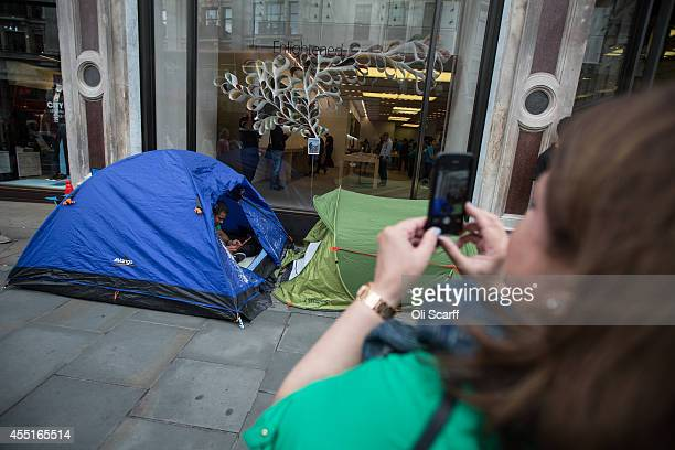 Shoppers wait in tents outside the Apple Store on Regent Street as they queue to be the first to purchase the forthcoming 'iPhone 6' mobile phone on...