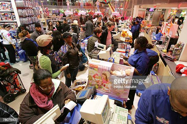 Shoppers wait online to pay for their goods at Toys 'R' Us in Times Square November 23 2007 in New York City Black Friday the day after Thanksgiving...