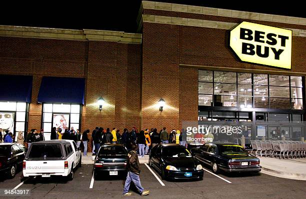 Shoppers wait outside a Best Buy store in Atlanta Georgia for a 5AM opening Friday November 25 2005