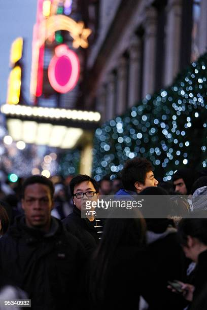 Shoppers wait outside Selfridges as the store opens it doors on the first day of its winter sale on Boxing Day 2009 in London on December 26 2009 AFP...
