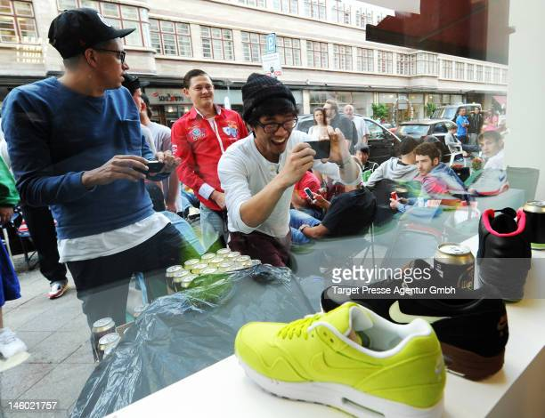 7907156c4011d Shoppers wait outside the  Solebox  store to buy the new Nike Air Yeezy 2