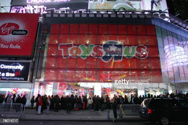 Shoppers wait outside Toys 'R' Us at Times Square before the store opens November 23 2007 in New York City Black Friday the day after Thanksgiving is...