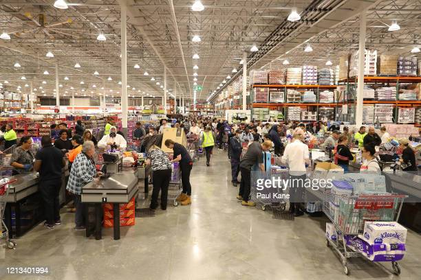 Shoppers wait to check out at Costco Perth on March 19 2020 in Perth Australia The store which is the first Costco in Western Australia is limiting...