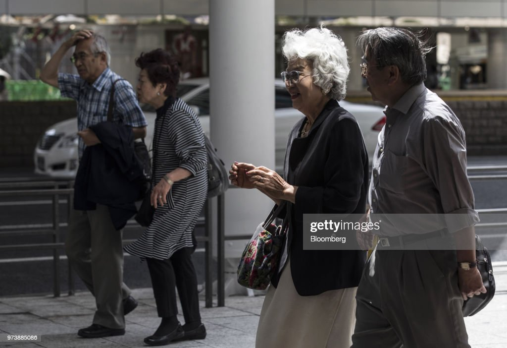 Shoppers walk along a sidewalk in the Ginza district of Tokyo, Japan, on Friday, May 25, 2018. The savings-rich elderly spend about 9.7 trillion yen ($87 billion) a year on their offspring and such spending last year accounted for about a third of the modest growth in total consumption, according toHiromichi Shirakawa, chief Japan economist at Credit Suisse Group. Photographer: Shiho Fukada/Bloomberg via Getty Images
