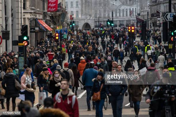 Shoppers walk along a temporarily pedestrianized Regent Street in London, U.K., on Saturday, Dec. 5, 2020. U.K. Retail landlords are facing a hard...