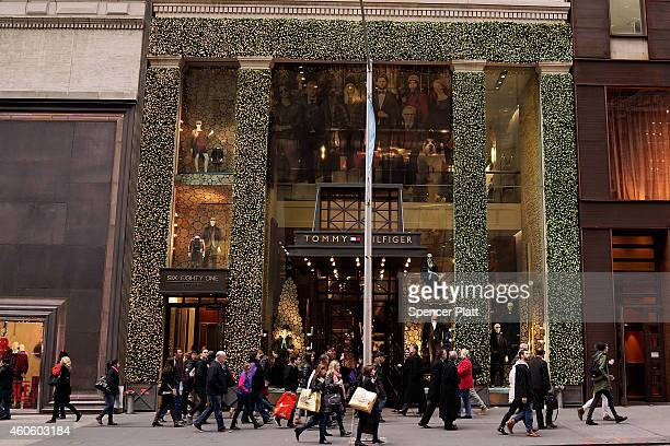 Shoppers walk along Fifth Avenue on December 17 2014 in New York City Thousands of people have descended onto New York City for the holiday season...