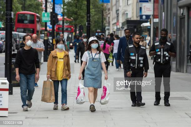 Shoppers walk along Oxford Street on 15 June, 2020 in London, England. Non-essential shops are allowed to reopen from today provided they abide by...