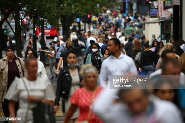 Shoppers walk along Oxford Street on July 31, 2021 in London, England. The United Kingdom, considered one of the advanced world's worst hit economies...