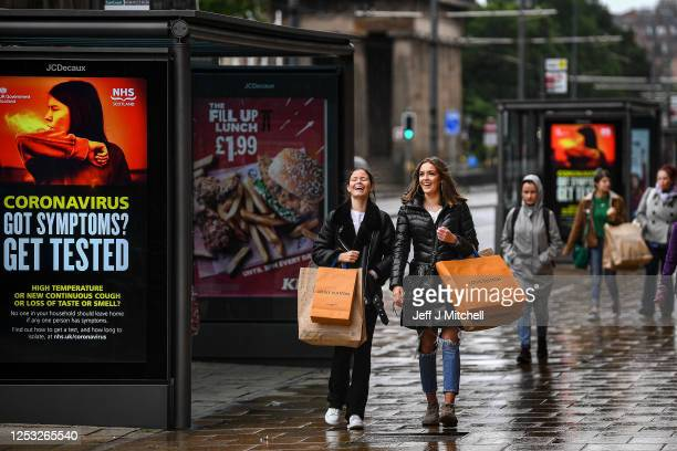 Shoppers walk along Princess Street as the Scottish Lockdown eases and shops reopen on June 29, 2020 in Edinburgh, Scotland. Shops with on-street...
