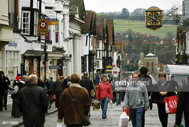 Shoppers walk along The High Street in Guildford Surrey on December 23 2008 AFP PHOTO / Adrian Dennis
