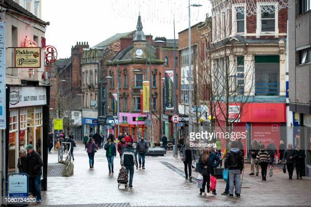 Shoppers walk along the high street in StokeonTrent UK on Monday Jan 7 2019 Stoke 135 miles north of the Palace of Westminster in London and once the...
