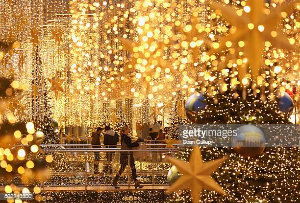 Shoppers walk among Christmas lights at a shopping mall two days before Christmas Eve on December 22 2015 in Berlin Germany Many shoppers are still...