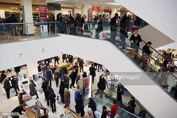 Shoppers walk around the flagship branch of the department store John Lewis in Oxford Street on January 2 2014 in London England Department stores...