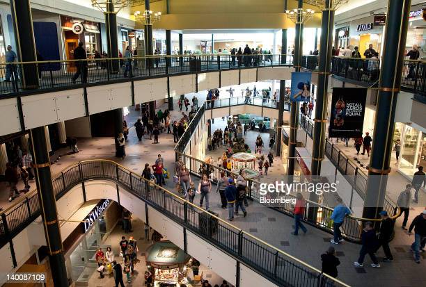 Shoppers walk around the Mall of America in Bloomington Minnesota US on Saturday Feb 25 2012 The New Yorkbased Conference Board is scheduled to...