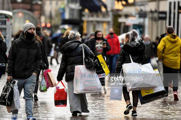 Shoppers walk down Buchanan Street before level four restrictions come into place later in the week on November 18, 2020 in Glasgow, Scotland. More...