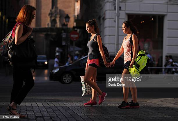 Shoppers walk down Gran Via street a day after Greeks voted in a referendum to reject the European Union's latest Bailout terms for the stricken...