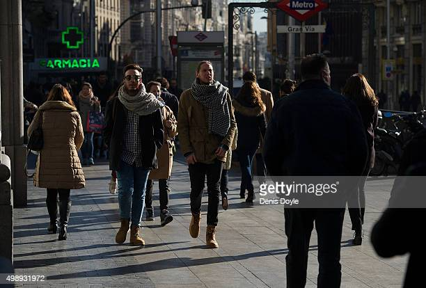 Shoppers walk down Gran Via street during 'Black Friday' discounts on November 27 2015 in Madrid Spain Originating in the USA as a sales day...