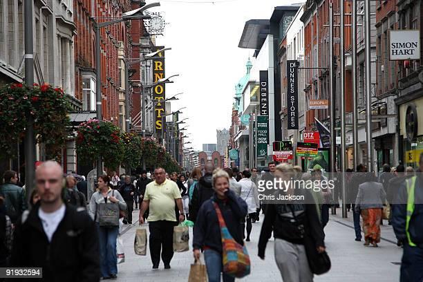 Shoppers walk down Henry Street on October 15, 2009 in Dublin, Ireland. Dublin is Ireland's capital city, located near the midpoint of Ireland's east...