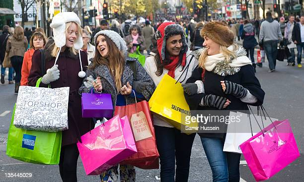 Shoppers walk down Oxford Street during American Express Shop West End VIP Weekend on DECEMBER 10 2011 in London England West End stores predict...