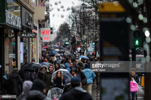Shoppers walk down Oxford Street on December 27 2017 in London England Fewer people have hit the high street for the postChristmas sales this year as...