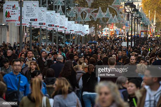 Shoppers walk down Portal De l'Angel street during 'Black Friday' discounts on November 27 2015 in Barcelona Spain Originating in the USA as a sales...
