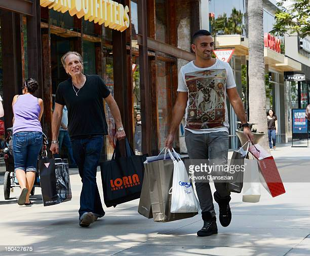 Shoppers walk down the Third Street Promenade's outdoor shopping mall on August 17 2012 in Santa Monica California According to reports consumer...