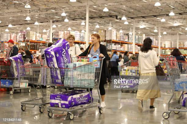 Shoppers walk from the store with their trolleys at Costco Perth on March 19 2020 in Perth Australia The store which is the first Costco in Western...