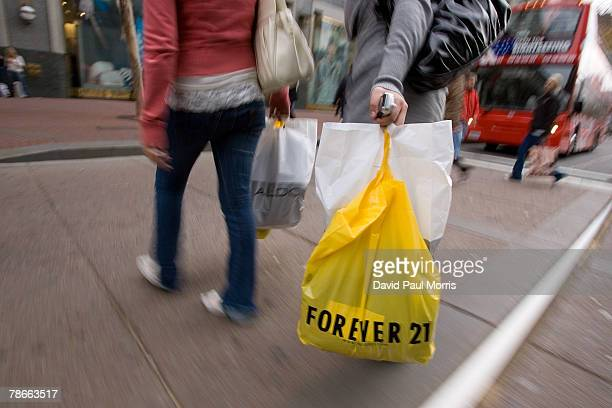 Shoppers walk in downtown San Francisco as they take advantage of the post-Christmas sales December 27, 2007 in San Francisco, California. The...