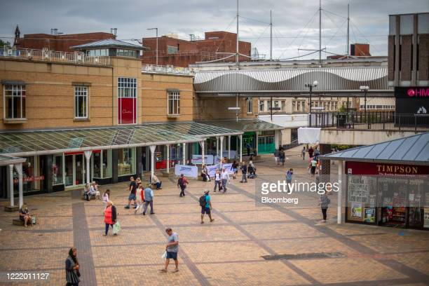 Shoppers walk in the outdoor plaza of the Merseyway shopping centre in Stockport, U.K., on Monday, June 22, 2020. The Brexit-supporting regions that...