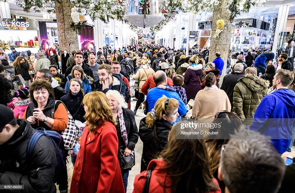 76a15e7ad Shoppers walk inside a Macy s store during Black Friday events on ...