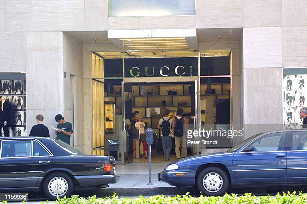 Shoppers walk inside the Gucci store on Rodeo Drive September 6 2001 in Beverly Hills CA