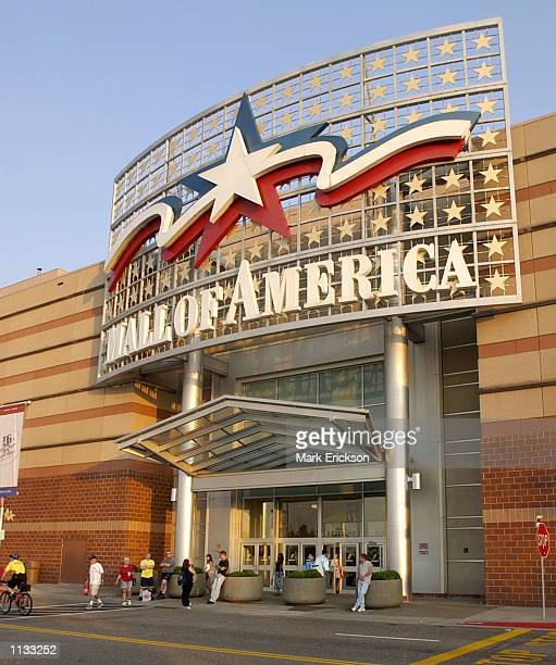 Shoppers walk into the Mall of America's north entrance July 16 2002 in Bloomington Minnesota The Mall of America is the largest shopping mall in the...