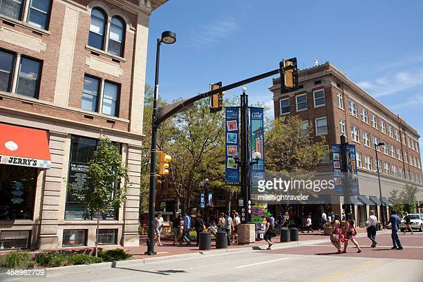 Shoppers walk on busy Pearl Street Mall Boulder Colorado