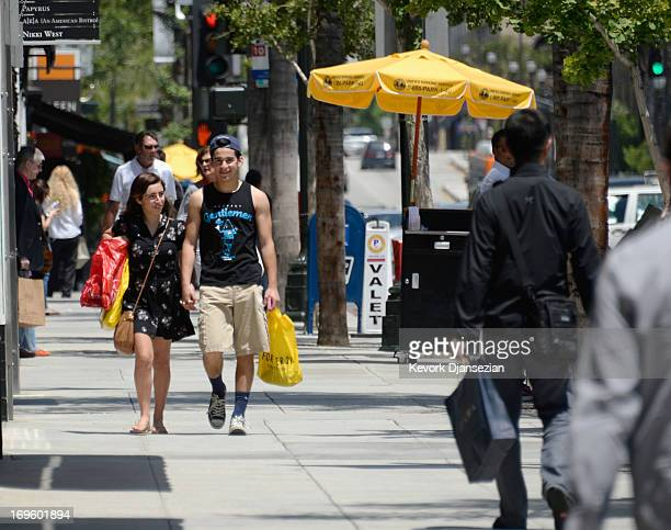 Shoppers walk on Colorado Street in Old Town on May 28 2013 in Pasadena California Consumer confidence index climbed to a fiveyear high and the US...