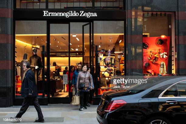 Shoppers walk out of an Ermenegildo Zegna store on New Bond Street on December 20 2018 in London England Figures released by the Office of National...