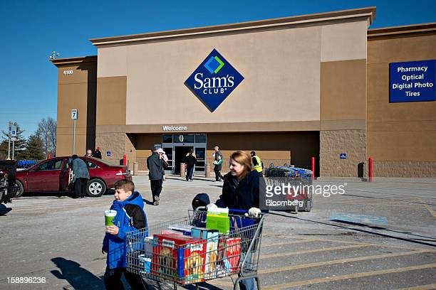 Shoppers walk outside a Sam's Club store in Peoria Illinois US on Wednesday Jan 2 2013 The International Council of Shopping Centers is scheduled to...