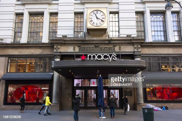 Shoppers walk outside the Macy's store at Manhattan's Herald Square January 11 2019 in New York Macy's boasts being the world's largest store