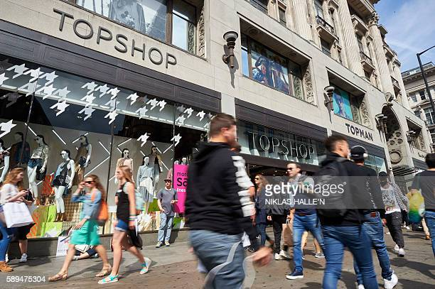 Shoppers walk past a branch of clothing retailer Topshop on Oxford Street in centarl London on August 13 2016 The Office for National Statistics...