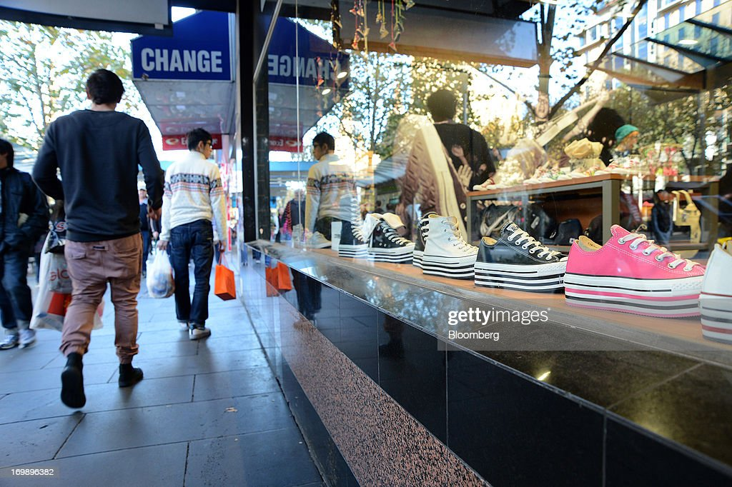 Shoppers walk past a Converse Inc. store on Swanston Street in central Melbourne, Australia, on Sunday, June 2, 2013. The Australian Bureau of Statistics is scheduled to release first-quarter gross domestic product data on June 5. Photographer: Carla Gottgens/Bloomberg via Getty Images