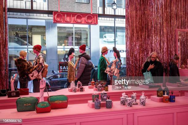 bcc0f3fa80 Shoppers walk past a Gucci display in a department store on Oxford Street  on December 17
