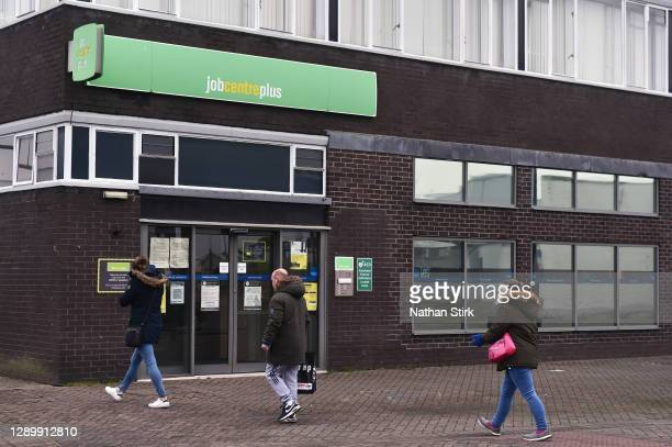 Shoppers walk past a Jobcentre Plus employment office on December 07, 2020 in Stoke-on-Trent, Staffordshire, England.