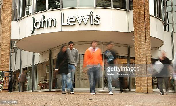 Shoppers walk past a John Lewis store on September 11 2008 in KingstonUponThames England John Lewis have stated that they face 'challenging'...