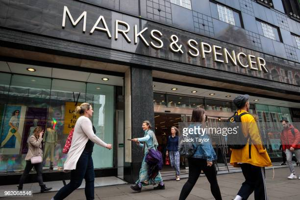 Shoppers walk past a Marks and Spencer store on Oxford Street on May 24 2018 in London England MS has suffered a sharp fall in profits following the...