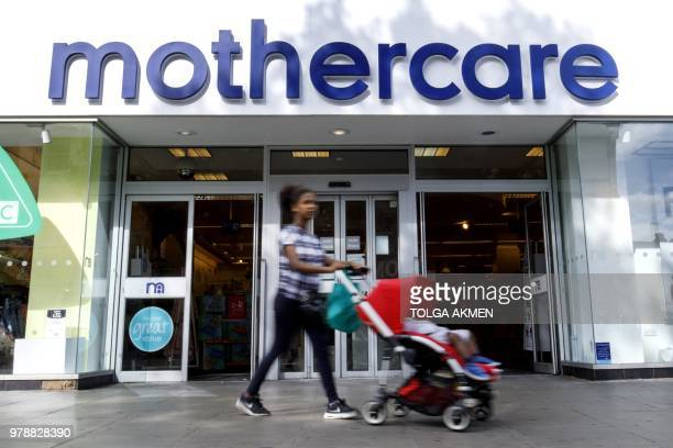 Shoppers walk past a Mothercare shop on Wood Green High Street in north London on June 19 2018 Major UK retailers are increasingly facing tough times...